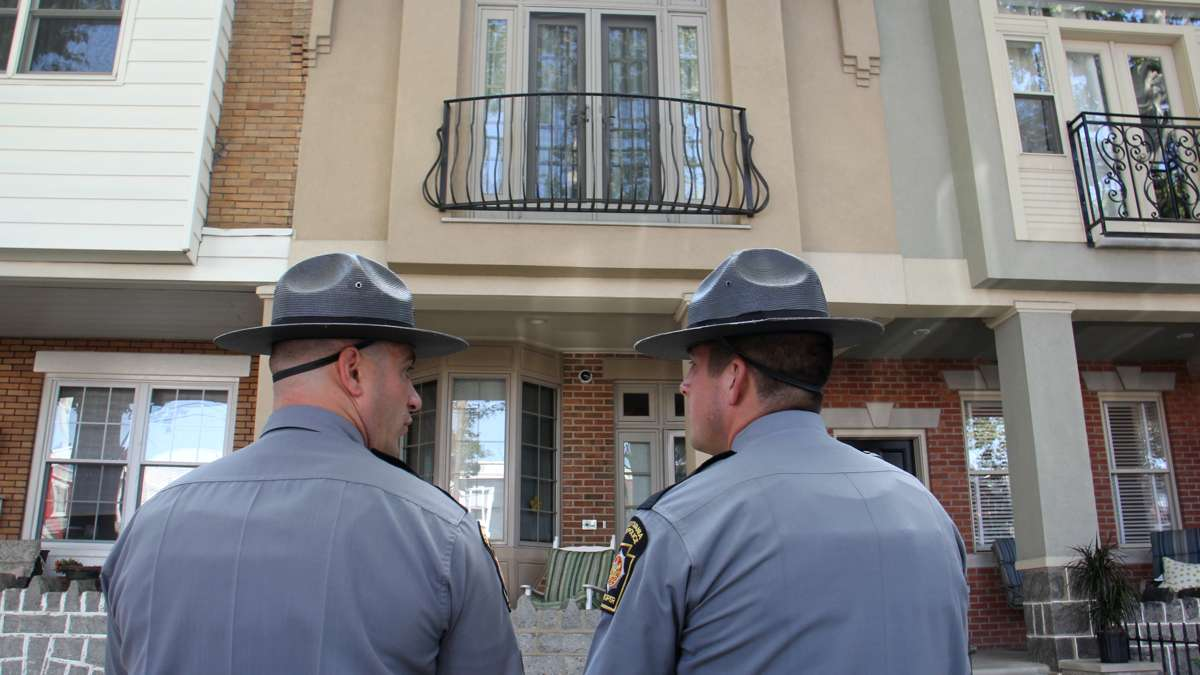 State troopers stand guard outside the home of union head John Dougherty in South Philadelphia. (Emma Lee/WHYY)