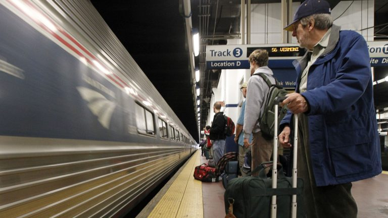 Passengers wait to board an Amtrak train at 30th Street Station in Philadelphia.  Pennsylvanians wants more train routes and more frequent trains on existing routes. Those proposals will take time and money. (AP File Photo/Alex Brandon)