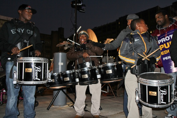 <p><p>Drummers Anthony Dandridge, 17, Strawberry Mansion H.S., Shemar Bates, 11, and Tyreses Wilks, 12, Duckrey Elementary, put a beat behind the crowds chanting. (Kimberly Paynter/WHYY)</p></p>