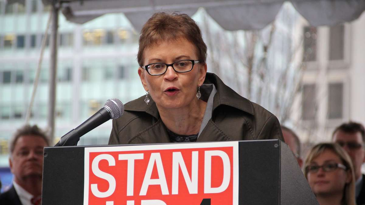 Acting Federal Transit Administration Administrator Therese McMillan speaks at a rally on Dilworth Plaza urging federal funding for transportation infrastructure improvements. (Emma Lee/WHYY)