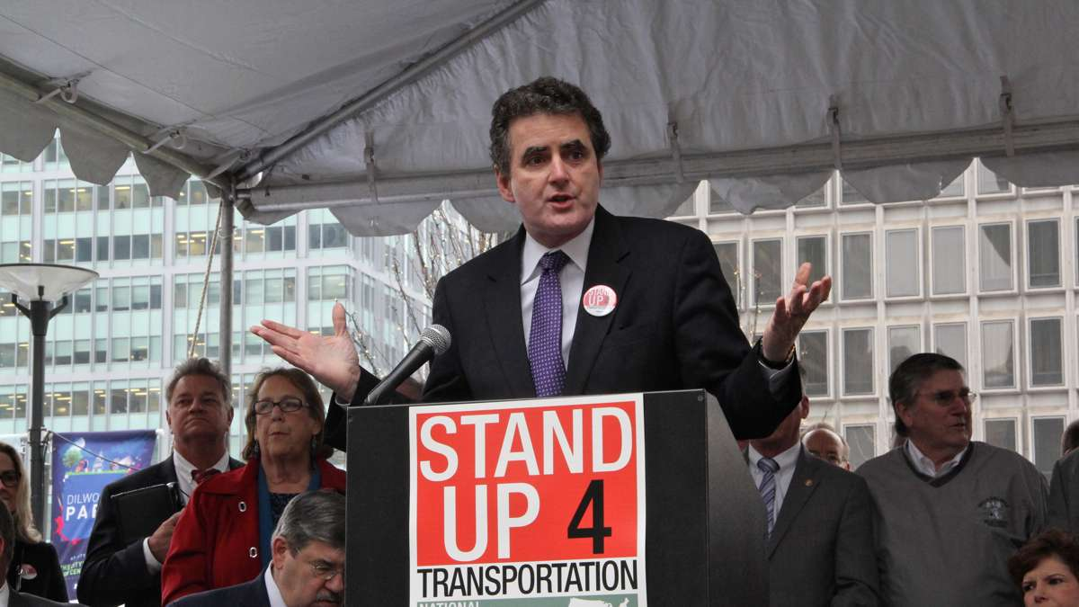 U.S. Rep. Michael G. Fitzpatrick speaks at a rally on Dilworth Plaza urging federal funding for transportation infrastructure improvements. (Emma Lee/WHYY)