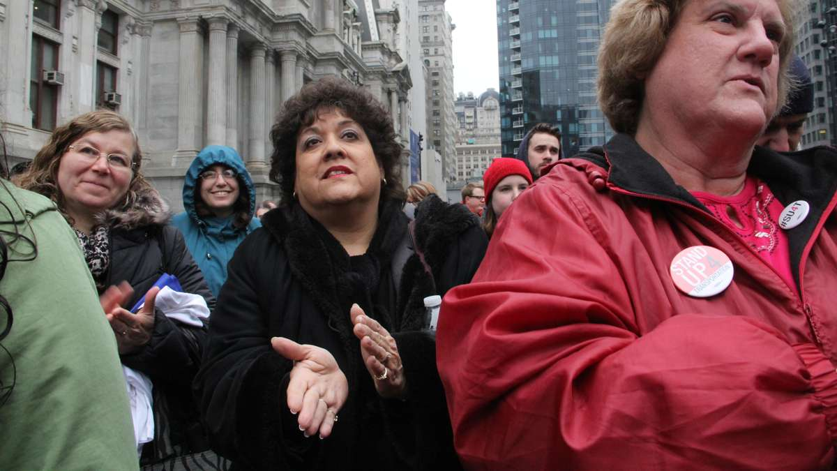 Stand Up 4 Transportation rally participants applaud speakers during the event at Dilworth Park. (Emma Lee/WHYY)