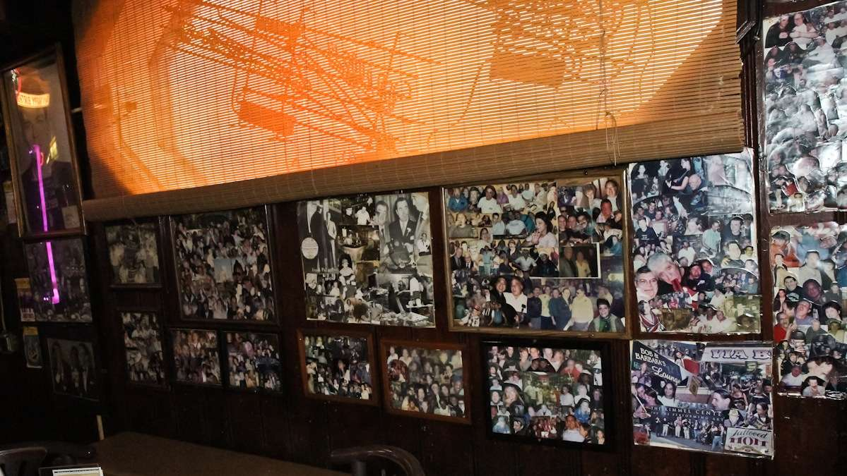 Customer photos from over 75 years are displayed on the walls of Ray's Happy Birthday Bar in South Philly. (Kimberly Paynter/WHYY)