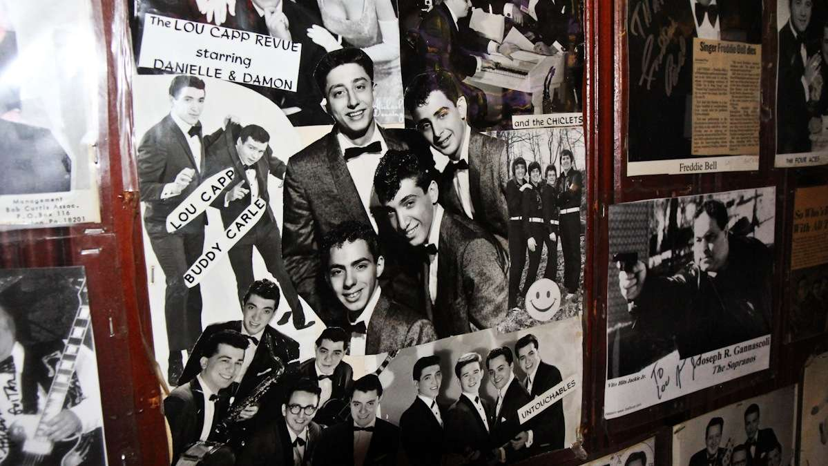 Owner Lou Capozzoli decorates the bar with images from his musical past. 'Never get old,' he says. (Kimberly Paynter/WHYY)