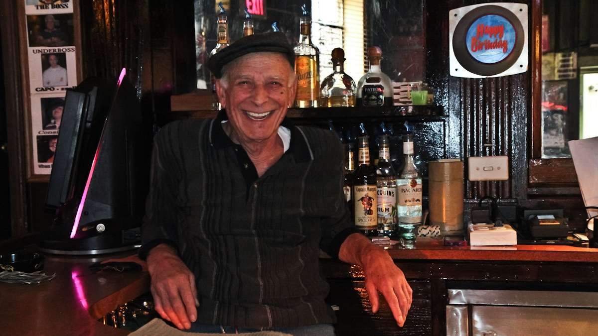 Tony Coccerino, bartender of 25 years, works the morning shift and says Ray's is a 'friendly bar, a neighborhood bar' that treats people right. (Kimberly Paynter/WHYY)