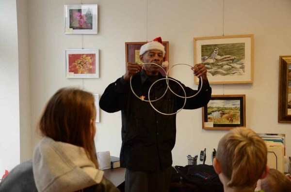 <p><p>Lamont Samuel performs a ring illusion during his performance at the Roxborough Development Corporation's children's party on Saturday afternoon. (Jimmy Viola/for NewsWorks)</p></p>