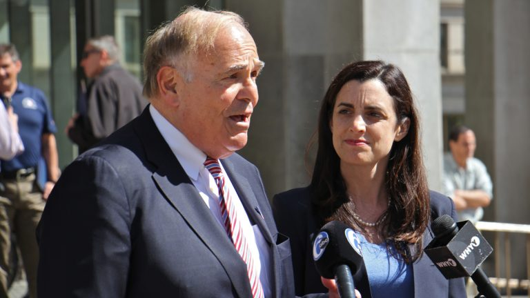 Former Pennsylvania Gov. Ed Rendell endorses Rebecca Rhynhart in the for Philadelphia city controller race during a press conference in front of the Municipal Services Building in Center City. (Emma Lee/WHYY)