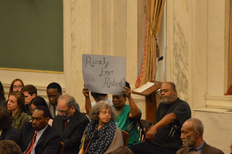 Meeting attendee sends message to council during hearing on Mayor Kenney's Rebuild initiative (Tom MacDonald/WHYY)