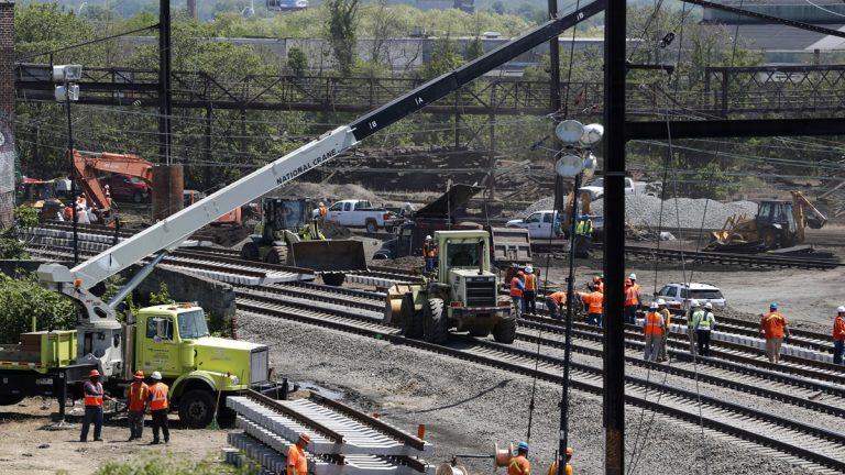 Amtrak is working to restore Northeast Corridor rail service between New York City and Philadelphia. Service was suspended after a train derailed Tuesday night, killing eight passengers. (AP Photo/Julio Cortez)