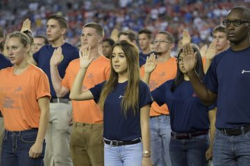 New military recruits take an oath during half time of an NFL football game between the Tampa Bay Buccaneers and the New York Giants Sunday, Nov. 8, 2015, in Tampa, Fla. (AP Photo/Phelan M. Ebenhack)