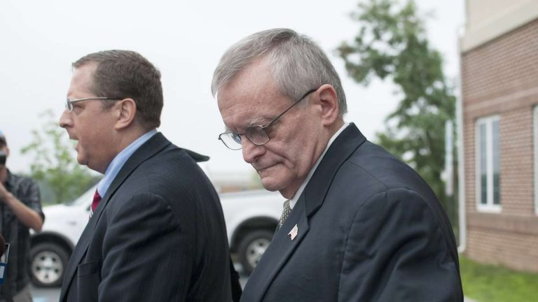 File image of former Harrisburg Mayor Stephen Reed (right) and attorney, Henry Hockeimer, in front of a suburban courthouse after being arrested on corruption charges, Tuesday, July 14, 2015. (Diana Robinson/WITF)