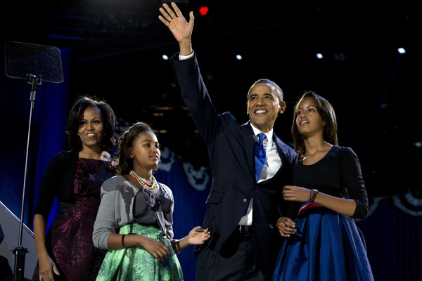 <p>President Barack Obama waves as he walks on stage with first lady Michelle Obama and daughters Malia and Sasha at his election night party Wednesday, Nov. 7, 2012, in Chicago. Obama defeated Republican challenger former Massachusetts Gov. Mitt Romney. (AP Photo/Carolyn Kaster)</p>
