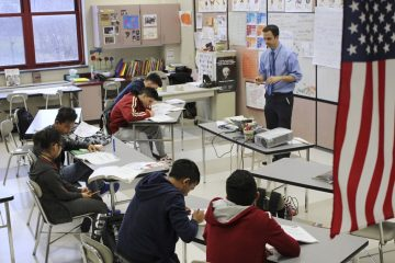 In this Feb. 15, 2017, photo, Eric Hoover teaches his class of immigrant and refugee students at McCaskey High School in Lancaster, Pa.  (AP Photo/Michael Rubinkam)