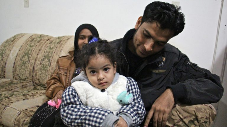 Refugees Mohammad Hasan, his daughter, Noor, 3, and wife, Noor, arrived in Philadelphia on Jan. 31, with the help of Nationalities Service Center. Since then, Donald Trump's immigration policies have slowed the flow of refugees and resettlement agencies have had to cut back. (Emma Lee/WHYY, file)