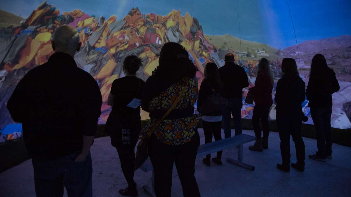 Patrons enter a dome for a 360-degree video experience which introduces them to the journeys of migrants worldwide.