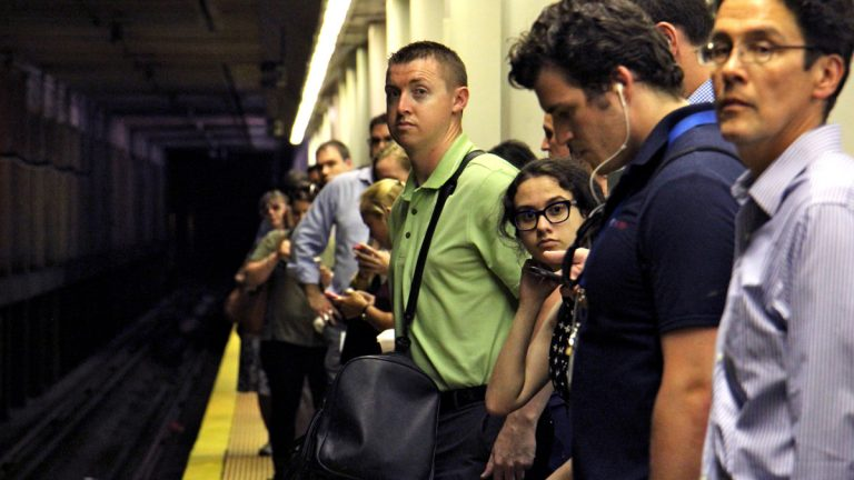 Commuters wait for a train at Suburban Station in Philadelphia. Beginning Monday
