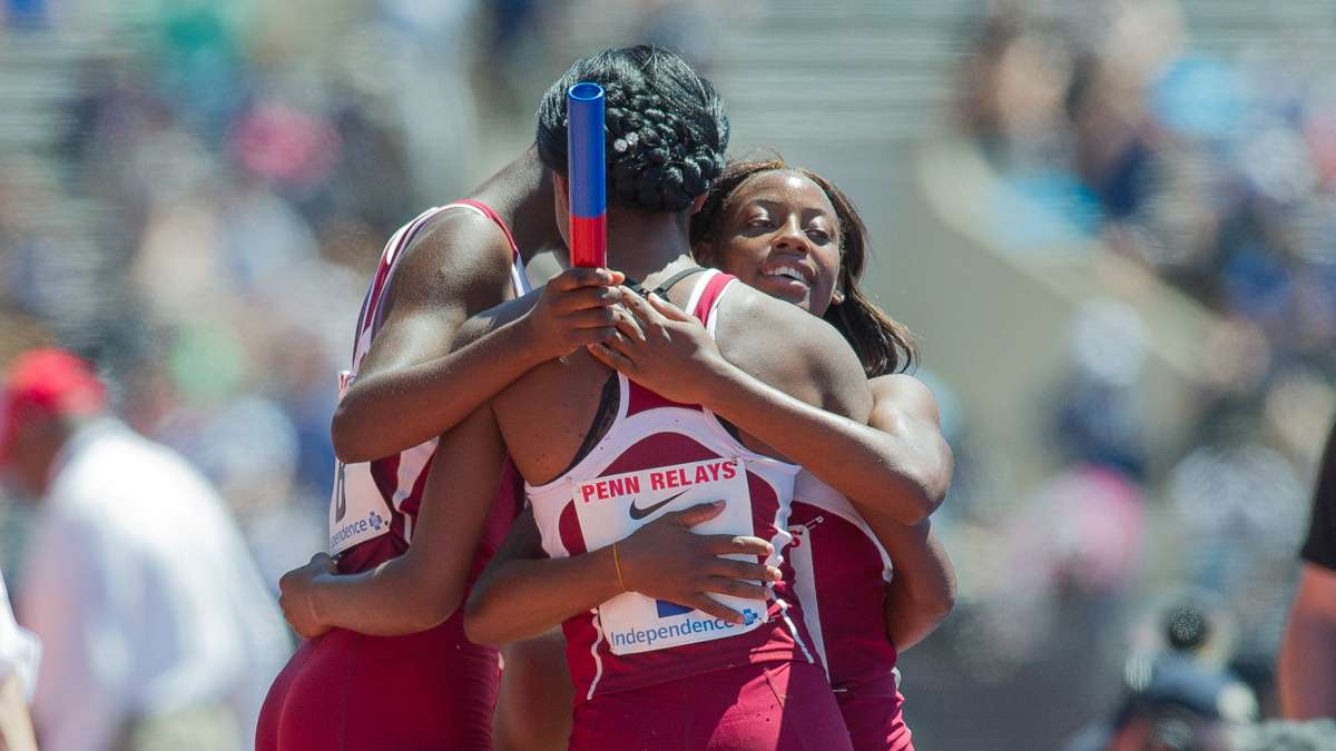 Edwin Allen's team celebrates after winning the the high school girls' 4-by-100 Championship of America. The team from Clarendon, Jamaica, won the race with a Penn Relays record time of 43.96 seconds.