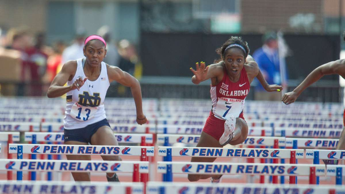 Oklahoma University's Olivia Haggerty edges out Notre Dame's Summer Thorpe in the college women's 100-meter hurdle heats.