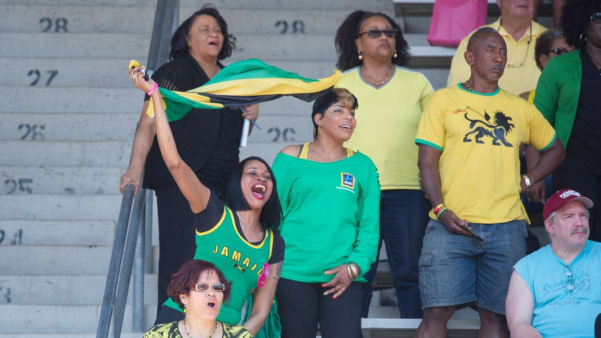 Fans supporting Vere Technical School in Clarendon, Jamaica, cheer as the girls team takes first place in the high school girls' 4-by-100 small school race with a time of 45.68 seconds.