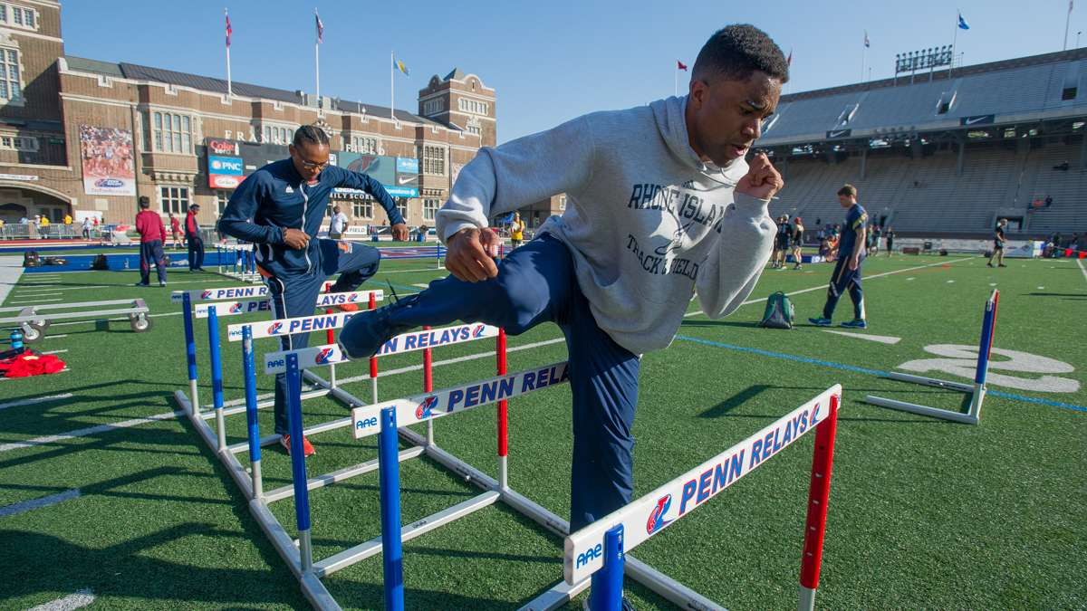 Adam Franklin of the University of Rhode Island warms up prior to the College Men's 400-meter hurdles championship. Franklin placed 8th in the event.