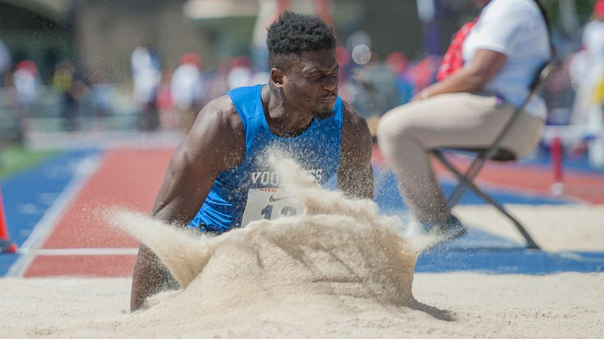 Voorhees College's Stephen Dishmond lands in the long jump pit during the college men's long jump championship. Dishmond placed 10th.