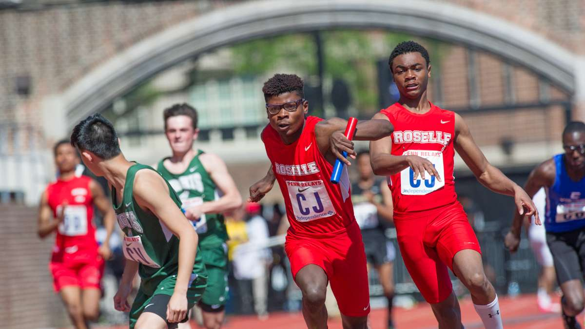Abraham Clark's Josh Fitts passes the baton to Backley Jean during the high school boys' 4-by-100 small school heats. The Roselle, New Jersey, school turned in a time of 43.91 seconds.