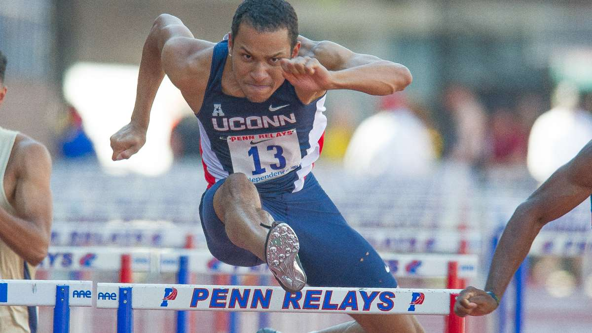 University of Connecticut's Stephon Henry clears the last hurdle in the first heat of the college men's 110-meter hurdles. Henry placed 10th overall.