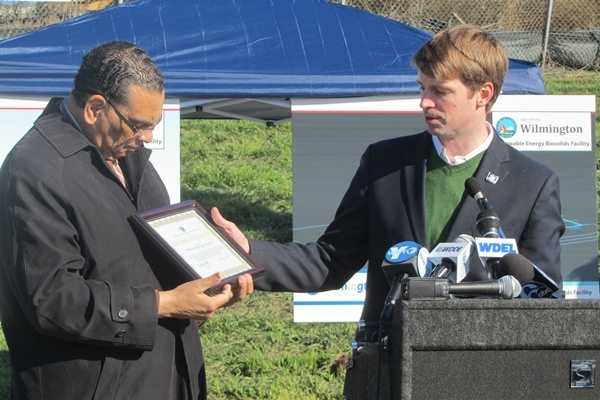 <p><p>DNREC Secretary Collin O'Mara presents Mayor Baker with a plaque recognizing his administration's efforts to improve the environment in the city of Wilmington. (Mark Eichmann/WHYY) </p></p>