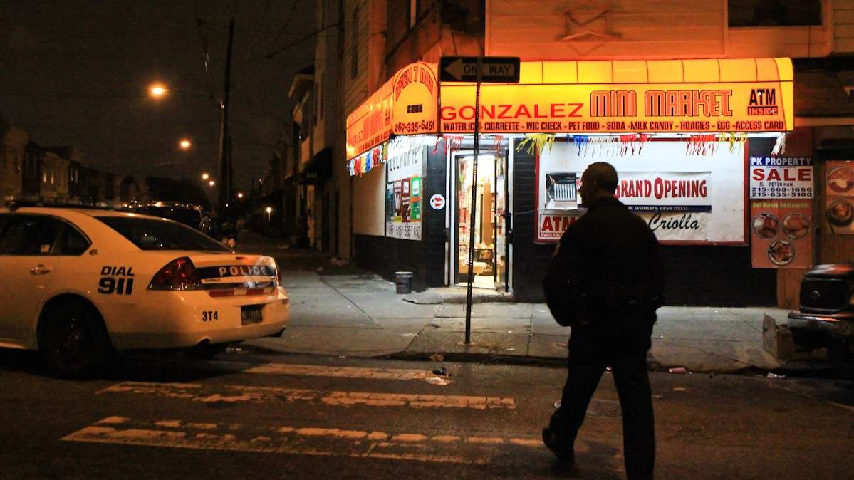 Officer Gerson 'Gus' Padilla heads into a South Philly corner store that experienced a theft a few moments before. (Kimberly Paynter/WHYY)