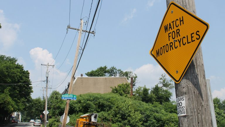 A warning sign near the scene of Tuesday morning's fatal motorcycle accident. (Matthew Grady/for NewsWorks)