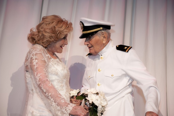 <p><p>Suzanne and Ralph Roberts reenact their wedding photo. Suzanne's dress for the 70th anniversary celebration is from David's Bridal (Photo courtesy of Susan Beard Design)</p></p>