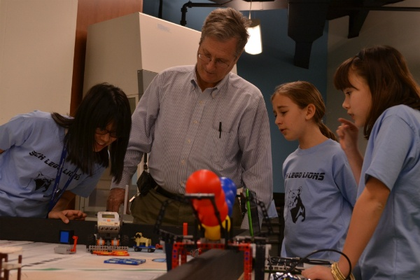 <p><p>SCH teacher Peter Randall works with the middle school girls' robotics team. (Zachary Shevich/for NewsWorks)</p></p>