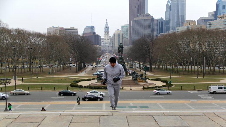 Rocky impersonator John Monforto runs up the steps of the Philadelphia Museum of Art. (Emma Lee/for NewsWorks)
