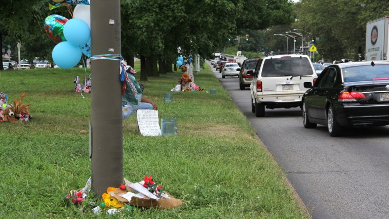 Memorials mark the area of Roosevelt Boulevard near 2nd Street where Samara Banks and three children were killed as they attempted to cross the 12-lane roadway. (Emma Lee/for NewsWorks)
