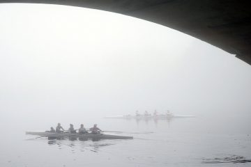 Rowers shrouded in fog move along the Schuylkill River in Philadelphia. (AP Photo/Matt Rourke)