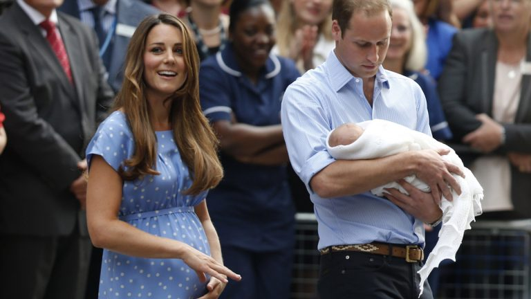 Britain's Prince William, right, and Kate, Duchess of Cambridge hold the Prince of Cambridge, Tuesday, July 23, 2013.  (AP Photo/Sang Tan)