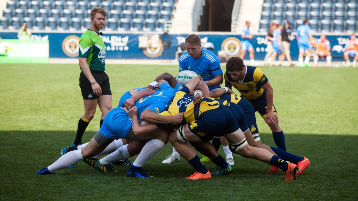A scrum between University of Michigan and UCLA during tthe Collegiate Rugby Championship at Talen Energry Stadium.