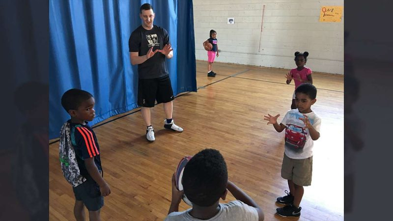 Program coordinator Dave Codell waits to catch a pass during a Rugby camp at the Northeast Frankford Boys & Girls Club (Jay Scott Smith/WHYY)