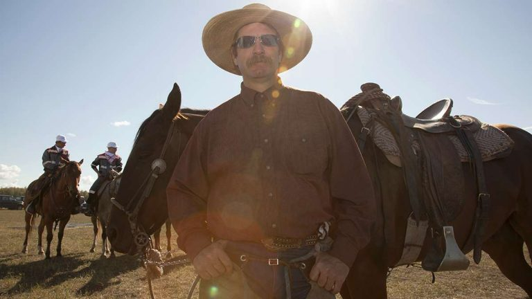Shawn Weekes, of Texas, is one of a handful of American cowboys currently working on Miratorg farms and helping train Russian cowboys. (Irina Zhorov/WHYY)
