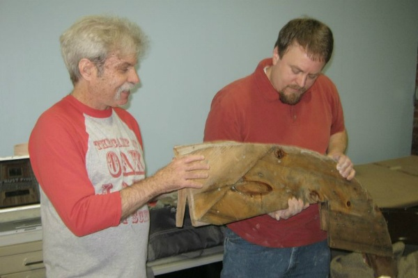 <p><p>Andy Walkerr (left) and Andy Heisey (right) show and discuss a piece of wood from RUST. (Alaina Mabaso/for NewsWorks)</p></p>