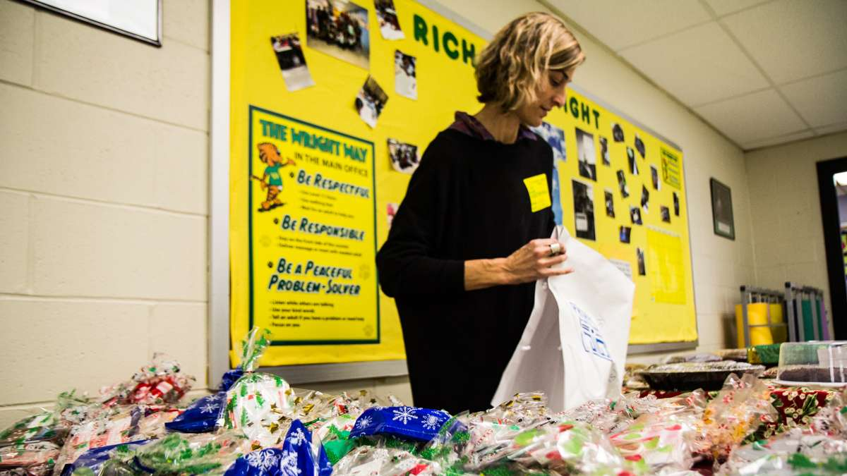 Bonnie Koss arranges gifts for the teachers of Richard Wright elementary.