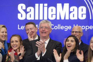Sallie Mae Chairman and CEO Raymond Quinlan, center, attends the opening bell ceremony with guests and employees at the Nasdaq MarketSite, Monday, Dec. 12, 2016, in New York. The company, which offers private education loans, is headquartered in Newark, Del. (AP Photo/Mark Lennihan)