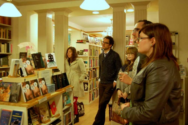<p><p>The Spiral Salon crowd listens and reflects on the reading. (Anna Flint/for NewsWorks)</p></p>