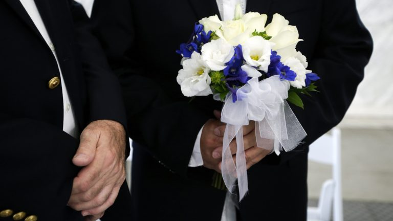Rick Nelson Flor, right, holds a flower bouquet as he stands next to his partner Robert O'Rourke before their wedding ceremony in West Hollywood, Calif., Monday, July 1, 2013.  (AP Photo/Jae C. Hong, file)