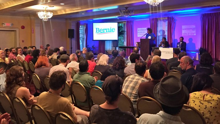 Bernie Sanders supporters gather at 1199C Union Hall in Philadelphia for a televised address by the Democratic presidential hopeful. (Bobby Allyn/WHYY)