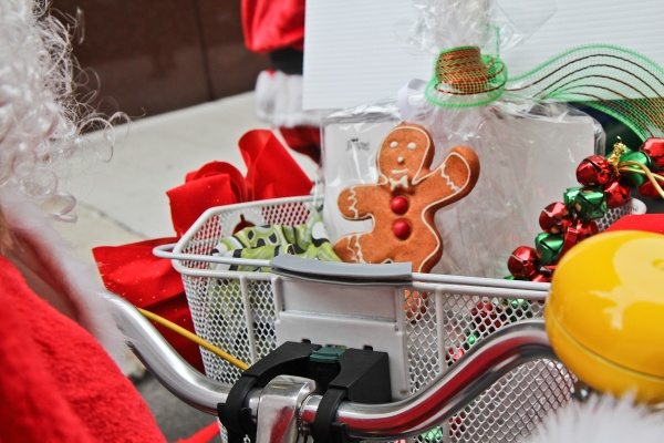 "<p><p>The Dranoff Santas' baskets were filled with toys and treats for needy children. ""Santas can come on a bike as well as a sled, it's just as good!"" said company president Carl Dranoff. (Kimberly Paynter/WHYY)</p></p>"