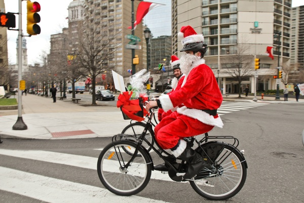 <p><p>Employees of the Dranoff Properties dressed as santa and rode bikes through Center City to deliver toys to Catholic Social Services. (Kimberly Paynter/WHYY)</p></p>