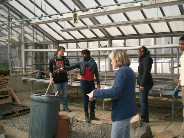 <p><p>Saul teacher Barbara Brown discusses display details with students Pajtim Saiti, Chelsea Bennett, Micet Coleman, and Rhonell Davis. (Carrie Hagen/for NewsWorks)</p></p>