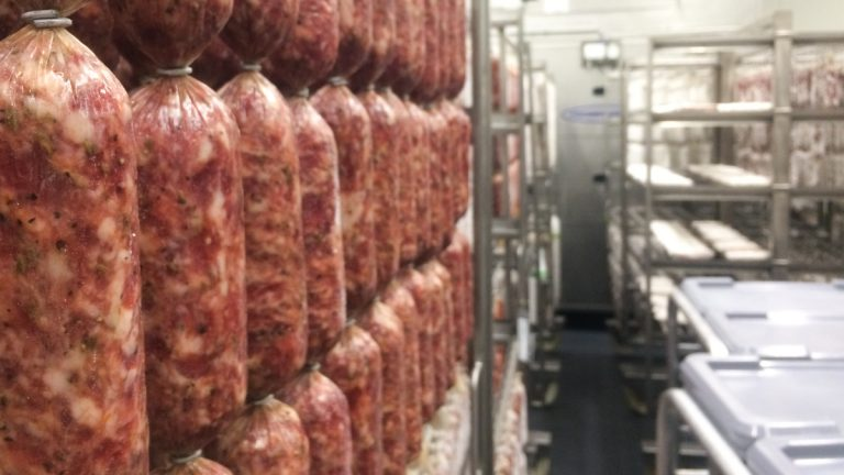 All the curing at New England Charcuterie is done in one large drying room. (Alan Yu/WHYY)