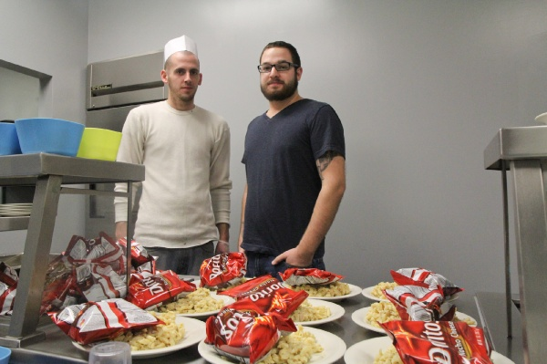 <p><p>Overcomer Josh Curtis and Nick Lordi, the mission's Ministry Director. Lordi said that the mission would benefit from having a lot of volunteers year round; not just on Thanksgiving. (Kimberly Paynter/for NewsWorks)</p></p>